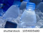 water bottle in ice fresh water | Shutterstock . vector #1054005680