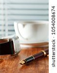 pen  coffee and clock on a... | Shutterstock . vector #1054008674