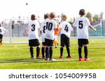 kids football team. young boys... | Shutterstock . vector #1054009958