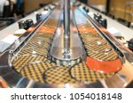 conveyor belt sushi in japan... | Shutterstock . vector #1054018148