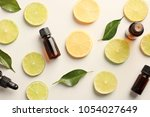 bottles of essential oils and... | Shutterstock . vector #1054027649
