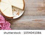 new york cheesecake on wooden... | Shutterstock . vector #1054041086
