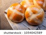 hot cross buns on basket top...   Shutterstock . vector #1054042589