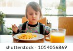 little cute child girl with... | Shutterstock . vector #1054056869