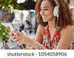 sideways portrait of happy... | Shutterstock . vector #1054058906