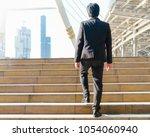 businessman walking outdoor in... | Shutterstock . vector #1054060940