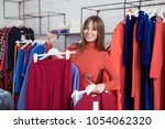 happy young customer in the...   Shutterstock . vector #1054062320