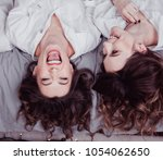 young happy girls in white...   Shutterstock . vector #1054062650