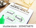 clipboard with holistic health... | Shutterstock . vector #1054076870