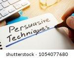 man writing persuasive... | Shutterstock . vector #1054077680