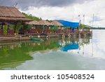 floating restaurant on the dam | Shutterstock . vector #105408524