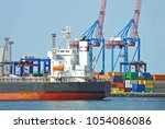 bulk cargo ship under port... | Shutterstock . vector #1054086086
