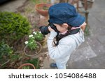 little girl to take a picture | Shutterstock . vector #1054086488