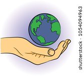 worlds earth day. earth in hand.... | Shutterstock .eps vector #1054094963