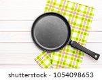 frying pan with kitchen towel... | Shutterstock . vector #1054098653