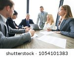group of business people and... | Shutterstock . vector #1054101383
