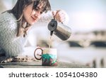 girl drinks coffee and reads... | Shutterstock . vector #1054104380