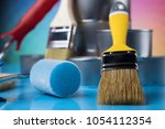 tin cans with paint  brushes... | Shutterstock . vector #1054112354