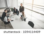 employees taking seat in the... | Shutterstock . vector #1054114409
