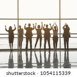 backs of triumphant men and...   Shutterstock . vector #1054115339