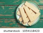heap of wafers in plate on old... | Shutterstock . vector #1054118423