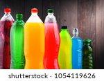 plastic bottles of assorted... | Shutterstock . vector #1054119626