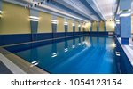 swimming pool in modern gym... | Shutterstock . vector #1054123154