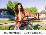 young woman with bike. girl in... | Shutterstock . vector #1054138850