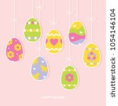 painted easter eggs hanging on... | Shutterstock .eps vector #1054146104