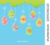 painted easter eggs hanging... | Shutterstock .eps vector #1054146110