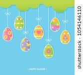 painted easter eggs hanging... | Shutterstock .eps vector #1054146110