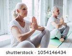 senior couple is doing fitness... | Shutterstock . vector #1054146434