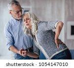 senior couple at home....   Shutterstock . vector #1054147010
