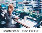 blonde young woman calling to... | Shutterstock . vector #1054149119