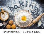 baking ingredients. bowl  eggs  ... | Shutterstock . vector #1054151303