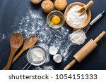 baking ingredients. bowl  eggs  ... | Shutterstock . vector #1054151333