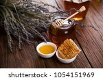 honey dripping from a wooden... | Shutterstock . vector #1054151969