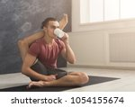 young sporty man in flexible... | Shutterstock . vector #1054155674