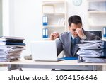 overloaded with work employee... | Shutterstock . vector #1054156646