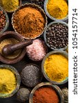 hot spices in wooden bowls | Shutterstock . vector #1054157714
