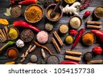 hot spices in wooden bowls | Shutterstock . vector #1054157738
