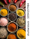 variety of spices and herbs on... | Shutterstock . vector #1054157984
