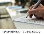 closeup of hand writing filling ... | Shutterstock . vector #1054158179