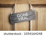 gone viral sign on office door ... | Shutterstock . vector #1054164248
