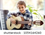 happy smiling boy learning to... | Shutterstock . vector #1054164260