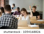 Small photo of Happy female worker gesturing Yes satisfied with good news on stock market and company business success while working in coworking space. Student excited with high evaluating grade. Reward, recompense