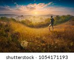 man standing on a hill in a... | Shutterstock . vector #1054171193