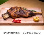 a large piece of lamb on the... | Shutterstock . vector #1054174670