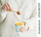 healthy vegan turmeric latte or ... | Shutterstock . vector #1054180199