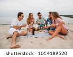 group of young smiling guys and ... | Shutterstock . vector #1054189520